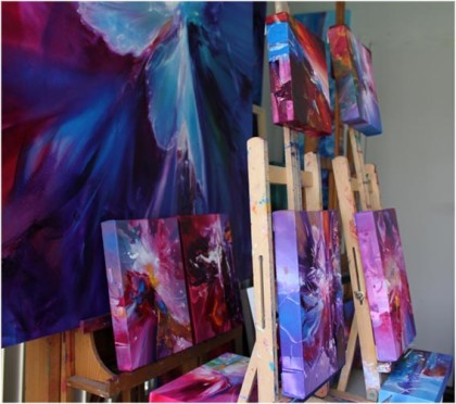 drying paintings on a small easels, showing the painted edges